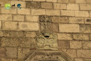 Stemma fronte Chiesa di Santa Barbara a Genoni
